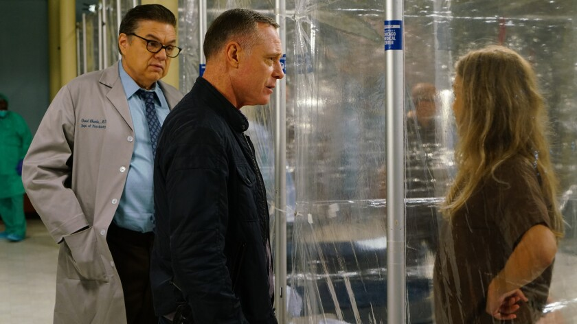 "Oliver Platt, left, Jason Beghe and Tracy Spiridakos in ""Chicago Med"" on NBC."