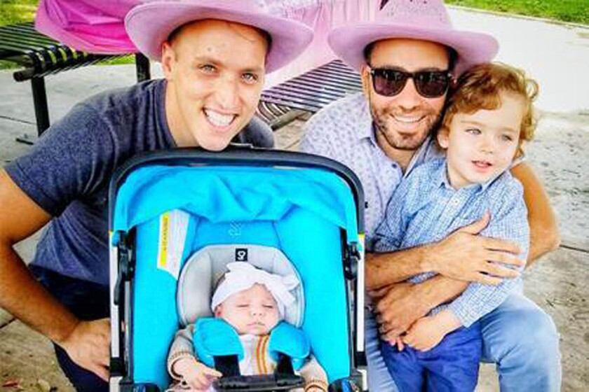 This undated photo provided by Immigration Equality shows Roee, left, and Adiel Kiviti, right, with their children newborn, Kessem and older brother Lev. A federal judge has ruled that the State Department must recognize that the daughter of the gay couple in Maryland has been a U.S. citizen since her birth in Canada via a surrogate last year. U.S. District Judge Theodore Chuang's order on Wednesday, June 17, 2020 rejects the State Department's position that the child was born out of wedlock because one of her married parents is not her biological parent. (Courtesy of Adiel and Roee Kiviti/Immigration Equality via AP)