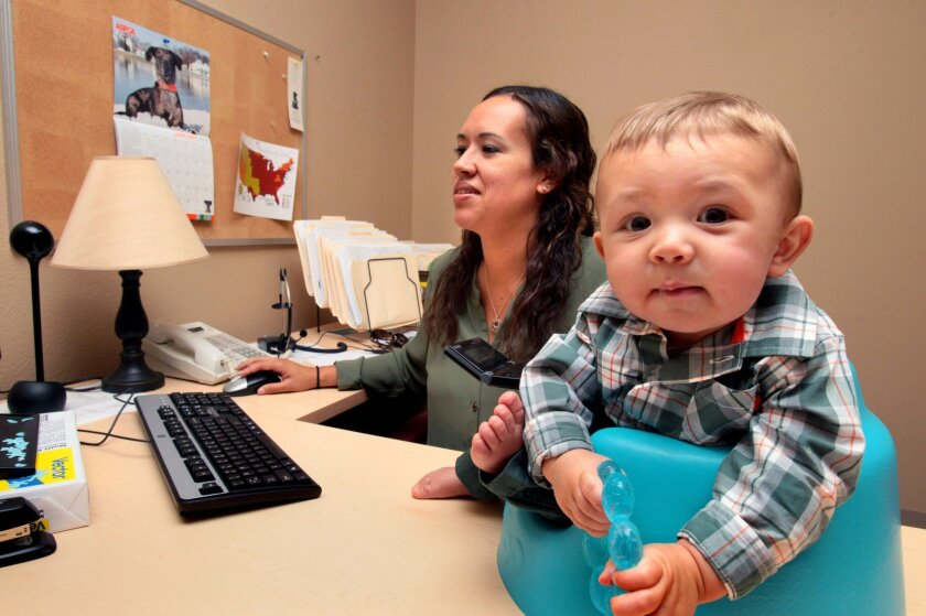 At Ken Blanchard Cos., Fadia Knight, a project manager, can bring her 6-month-old son, Emmett, to work with her, thanks to one of the perks offered by the Escondido firm.