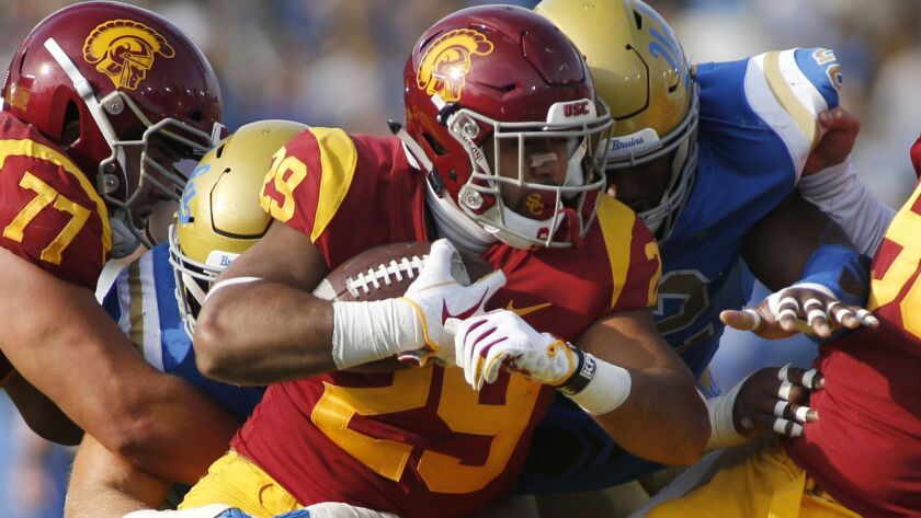 Trojans running back Vavae Malepeai fights for yardage during the Bruins' 34-27 victory last weekend, a game some shrugged off as meaningless.