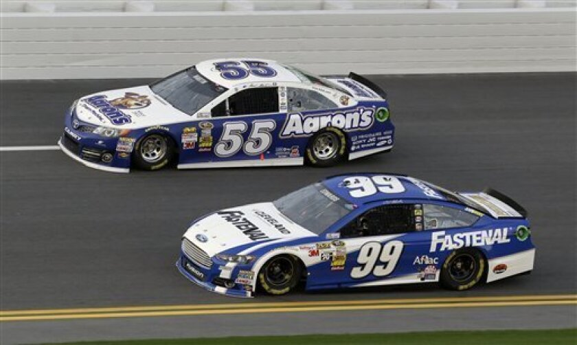 Carl Edwards (99) and Mark Martin (55) run side-by-side during practice for the NASCAR Sprint Unlimited Shootout auto race at Daytona International Speedway, Friday, Feb. 15, 2013, in Daytona Beach, Fla. (AP Photo/John Raoux)