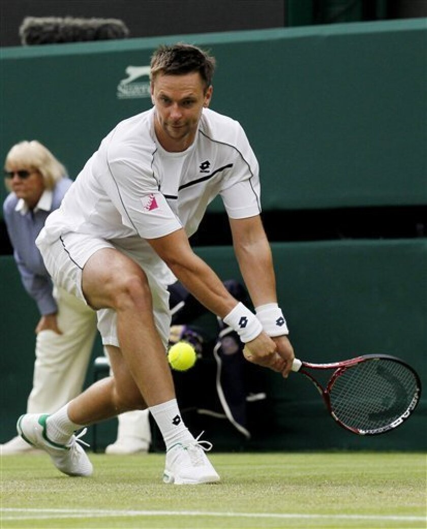 Sweden's Robin Soderling returns a shot to Australia's Lleyton Hewitt during their match at the All England Lawn Tennis Championships at Wimbledon, Thursday, June 23, 2011. (AP Photo/Anja Niedringhaus)
