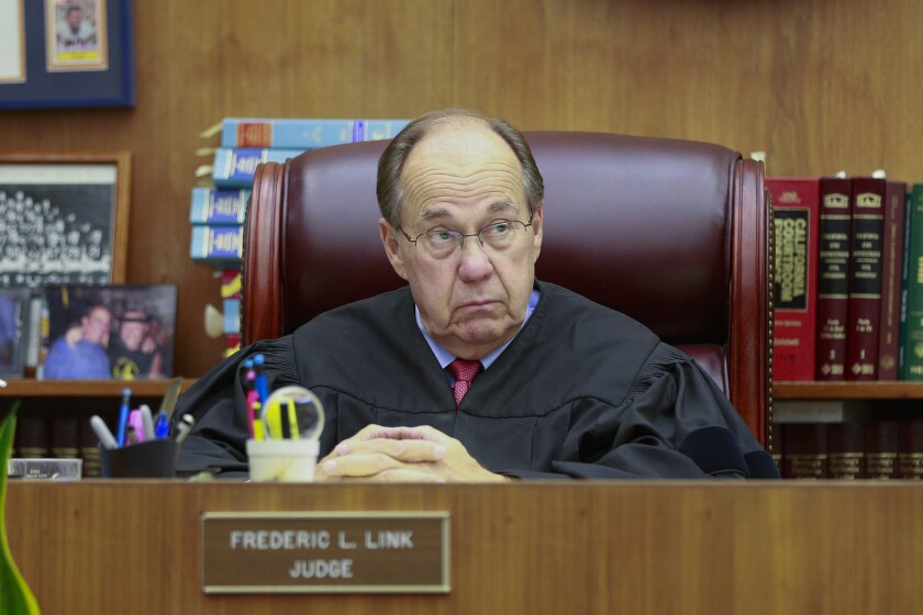Judge Frederic Link listens during opening statements in the  trial for Ignacio Canela who is accused of shooting a San Diego police officer during a chase that ended up in City Heights storm drain.