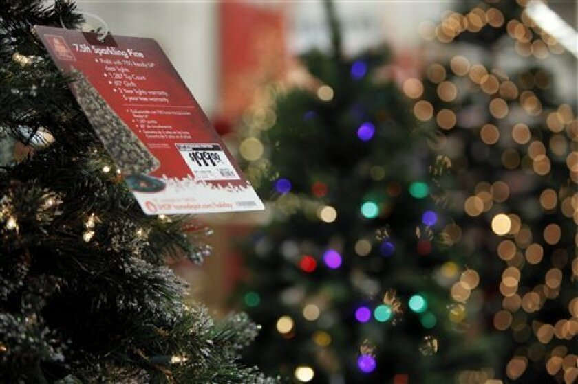 """FILE - In this Sept. 25, 2009 file photo, displays of Christmas decorations adorn the shelves of a Home Depot in Downers Grove, Ill. Some tips on how to save money on holiday decor are given in an Associated Press column called """"Smart Spending."""" (AP Photo/M. Spencer Green, file)"""