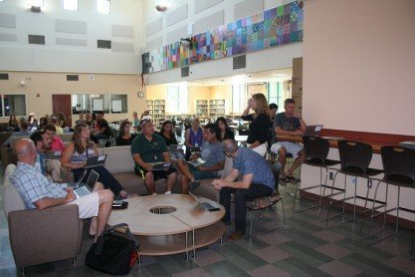 Carmel Valley Middle School staff members held their first meeting in the school's new media center on Aug. 21. Photo by Karen Billing
