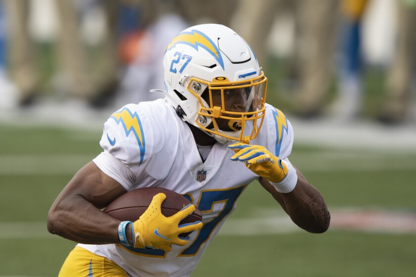 Chargers running back Josh Kelley carries the ball against the Cincinnati Bengals on Sunday.