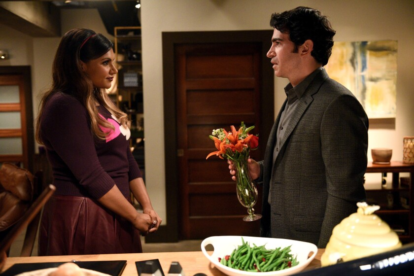 """Mindy Kaling and Chris Messina in a Season 3 episode of """"The Mindy Project."""" Following its cancellation on Fox, the show is moving to Hulu."""