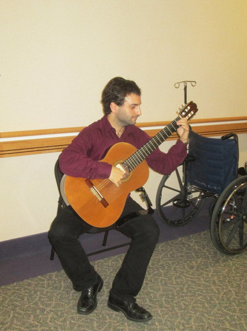 Guitarist Soran Dalawi performs for patients at Scripps Green Hospital in early December as part of a new healing concert series. Credit: Kimberly Corona