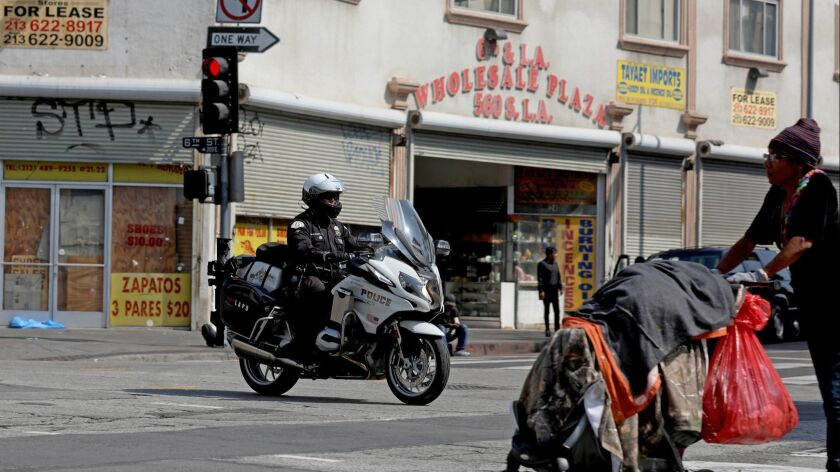LOS ANGELES, CALIF. -- THURSDAY, MAY 30, 2019: An LAPD motorcycle officer patrols along E. 6th Stree
