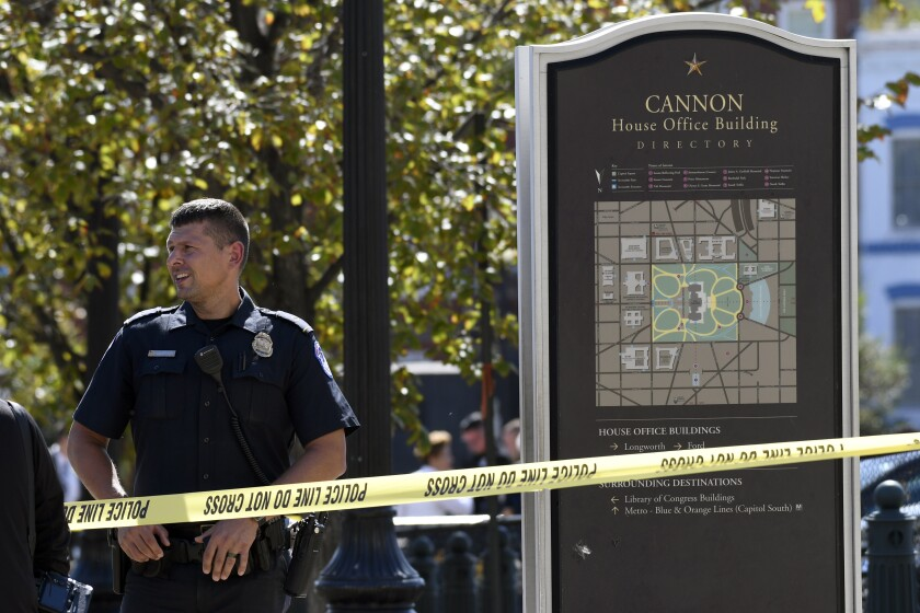 Police gather near the Capitol South Station Metro stop near Capitol Hill in Washington, Friday, Oct. 11, 2019. Police say a boy has been stabbed and seriously injured near the Capitol. The Metropolitan Police Department says officers are looking for a 14-year-old girl in connection with the stabbing. (AP Photo/Susan Walsh)