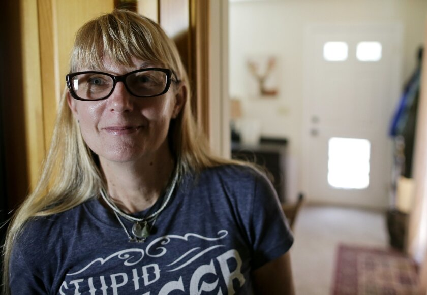 """In this Wednesday, May 18, 2016 photo, Terry Petrovich poses in her home in Jamul, Calif. Petrovich, who was diagnosed in 2012 with stage four non-Hodgkin's Lymphoma, asked her oncologist point blank: """"Am I going to count on you to help me achieve a good death?"""" A number of doctors in California s"""