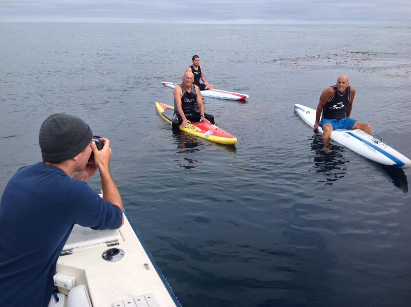 Gage Hingeley films paddlers Wally Buckingham, Bob Schade and Wayne Buckingham for his documentary.