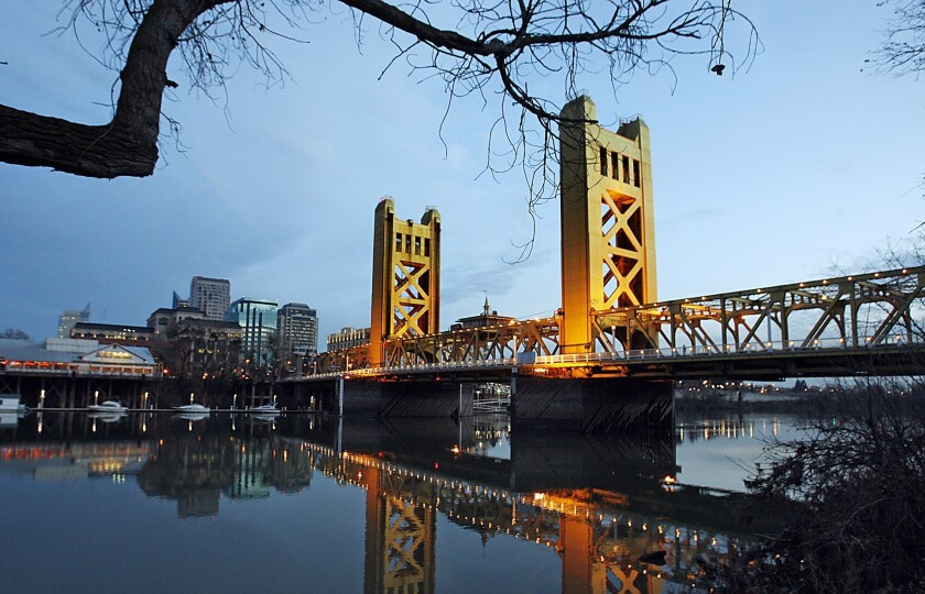 Downtown Sacramento rises from the banks of the Sacramento River near the historic Tower Bridge.