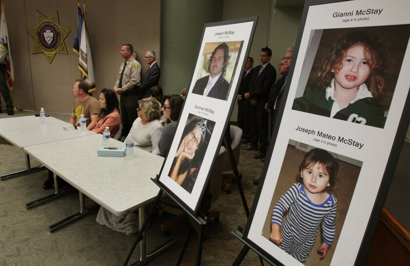 Photos of the missing McStay family are posted at the press conference at the San Bernardino County Sheriffs Office.