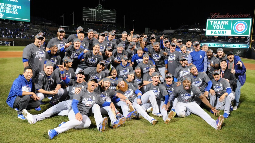 Dodgers players celebrate the National League pennant after defeating the Chicago Cubs in the NLCS in 2017.
