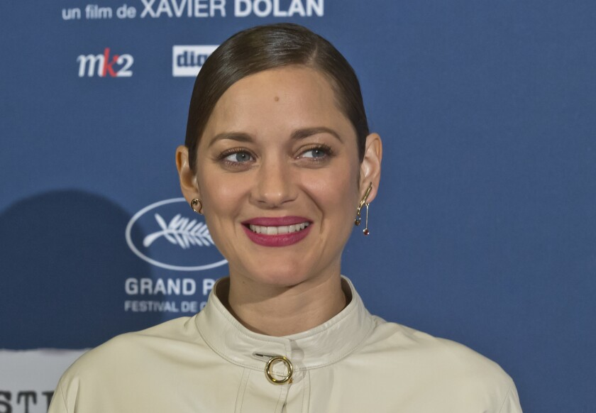 """French actress Marion Cotillard poses upon her arrival at the screening of the film """"Juste la Fin du Monde"""" (""""It's Only the End of the World"""") in Paris, on Thursday, Sept. 15, 2016."""