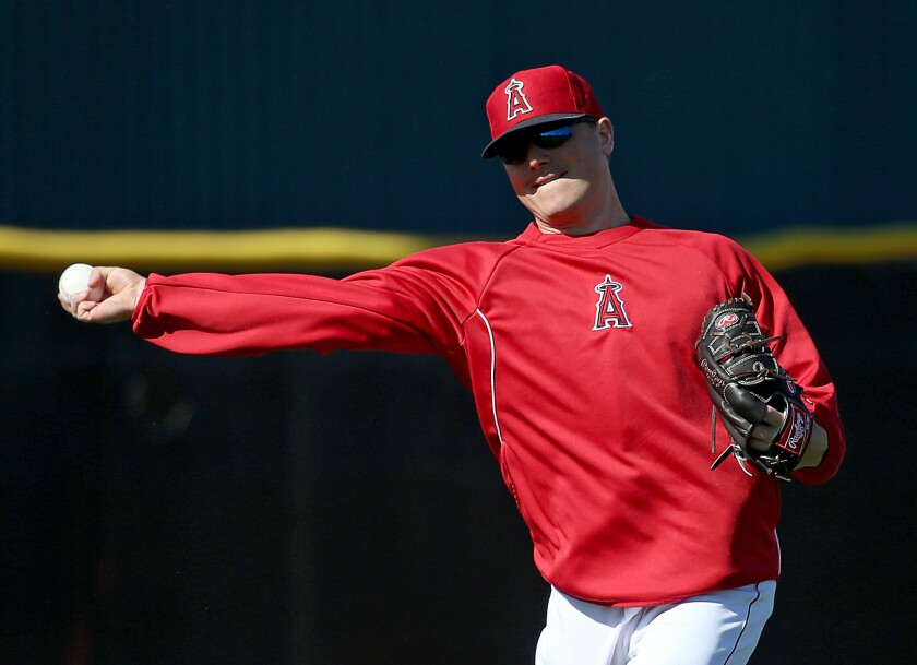 Angels pitcher Joe Smith warms up with his unique sidearm delivery.