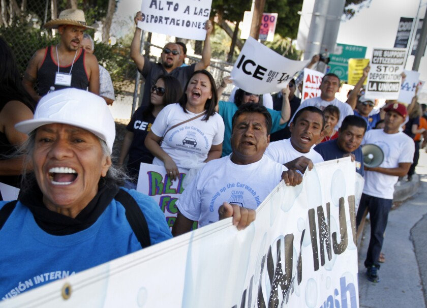 More than 200 immigrant workers, labor allies and community supporters marched in Los Angeles on Aug. 27.