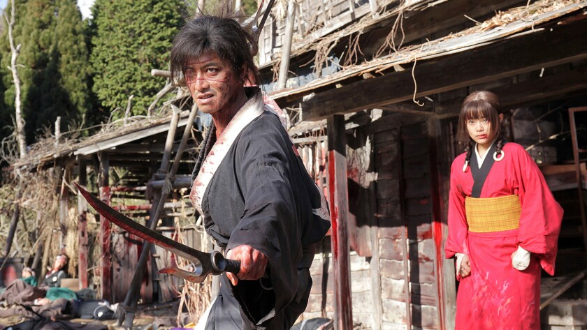 "Takuya Kimura and Hana Sugisaki in a scene from the movie ""BLADE OF THE IMMORTAL."" Credit: Magnet Re"