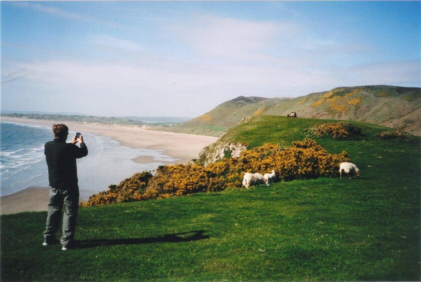 Stretching three miles from the tip of the Gower Peninsula in Wales, Rhossili Beach is a favorite for surfers and hang-gliders, and a familiar sight to visitors from San Diego, except for the grazing sheep.