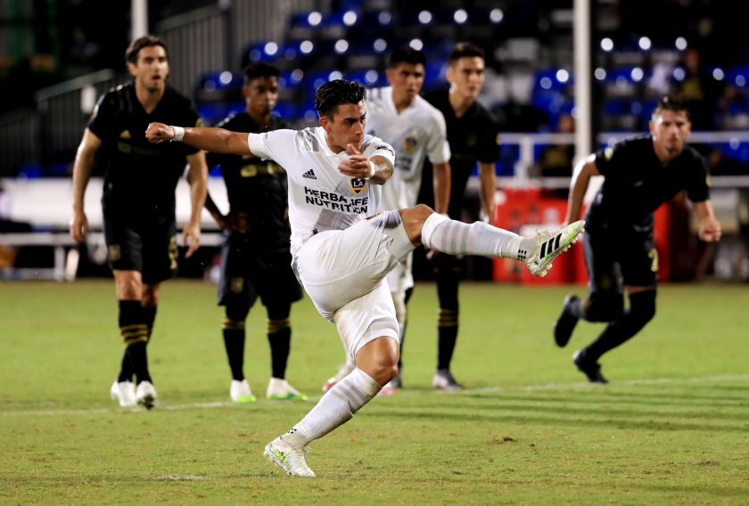Galaxy forward Cristian Pavon scores against LAFC on July 18.