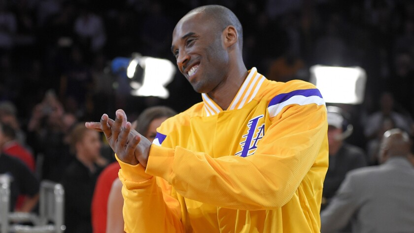 Lakers star Kobe Bryant claps during a ceremony recognizing him as the third-leading scorer in NBA history at Staples Center on Dec. 19.