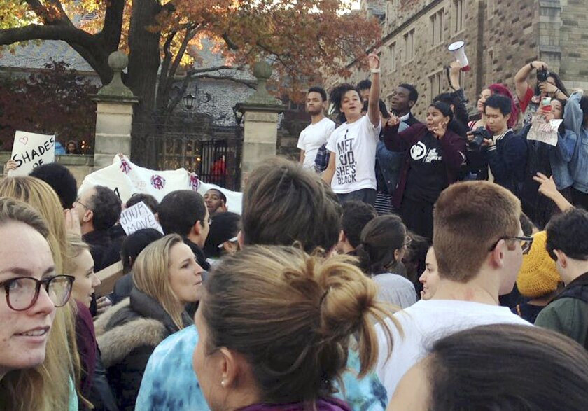 Yale University students and supporters participate in a march across campus to demonstrate against what they see as racial insensitivity at the Ivy League school on Nov. 9.
