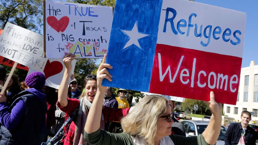 In this November 2015 file photo supporters of the Syrian People Solidarity Group protest in Austin, Texas, against Texas governor Greg Abbott's refusal to allow Syrian refugees in the state.