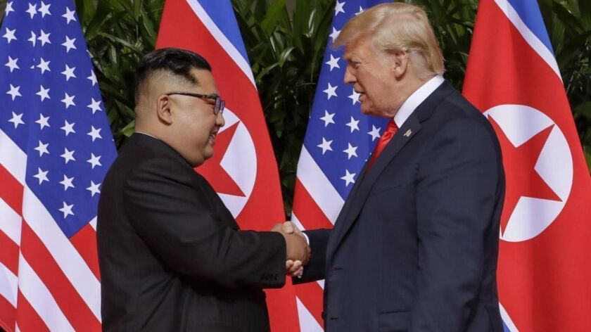 A historic handshake between President Trump and Kim Jong Un.