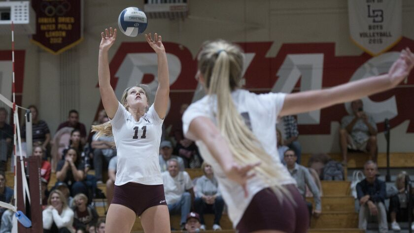 Laguna Beach's Soren Patchell sets the ball during Tuesday's first-round CIF-SS Division II playoff