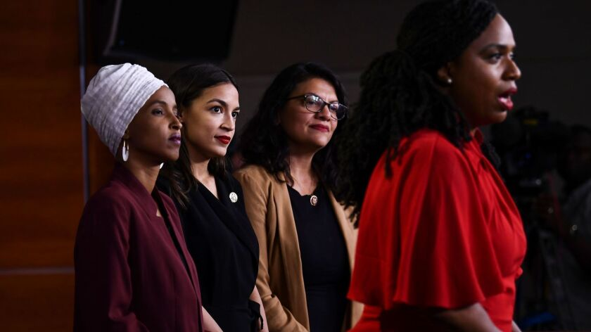 Rep. Ayanna Pressley (D-Mass.) speaks to reporters as Reps. Ilhan Omar (D-Minn.), from left, Alexandria Ocasio-Cortez (D-N.Y.) and Rashida Tlaib (D-Mich.) look on.