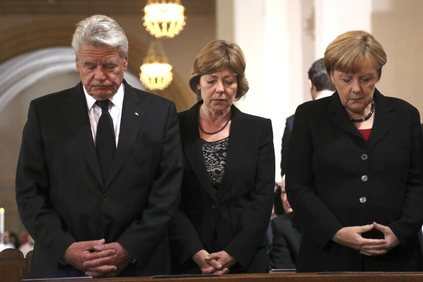 From left : German President Joachim Gauck, his partner Daniela Schadt and German chancellor Angela Merkel attend a memorial service for the nine victims of a shooting at the Olympia shopping center in Munich, Germany, Sunday, July 31, 2016. An 18-year-old German-Iranian man killed nine people and