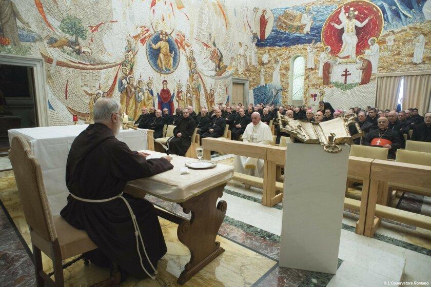 Pope Francis, center, listens to the Vatican's Lenten preacher Raniero Cantalamessa, left, at the Redemptoris Mater chapel, at the Vatican, Friday, Feb. 19, 2016. (L'Osservatore Romano/Pool Photo via AP)
