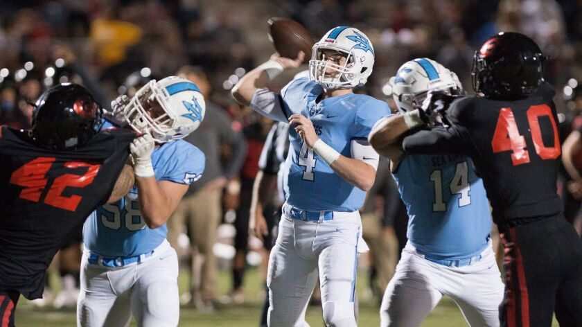 Corona del Mar?s Ethan Garbers is well protected while trowing a pass during Saturday?s CIF Southern
