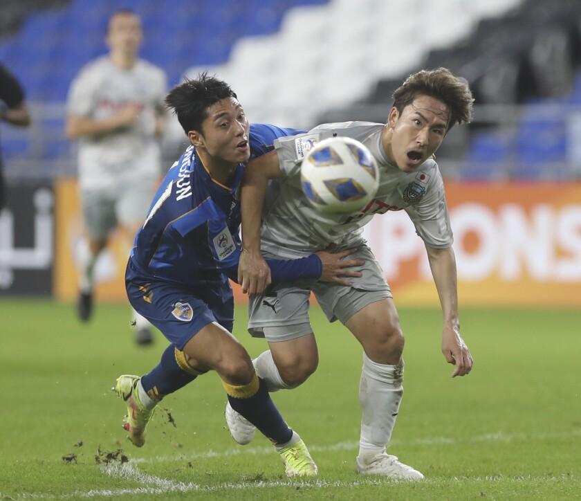Japanese Kawasaki Frontale' Kyohei Noborizato, right, fights for the ball against South Korean Ulsan Hyundai FC' Lee Dong-jun during the AFC Champions League in Ulsan, South Korea, Tuesday, Sept. 14, 2021. (Kim Yong-tae/Yonhap via AP)