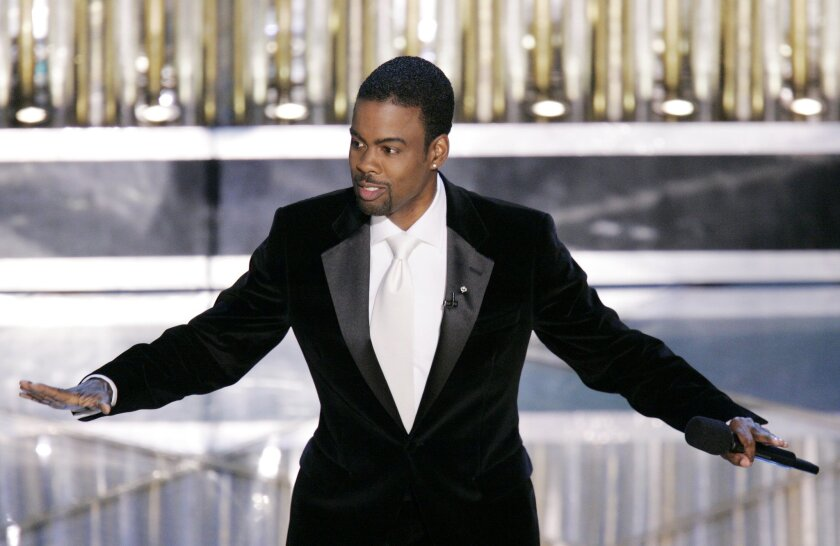 Oscar Host Chris Rock performs his monologue to open the 77th Academy Awards telecast in Los Angeles on Feb. 27, 2005. Rock hosts again this Sunday evening.