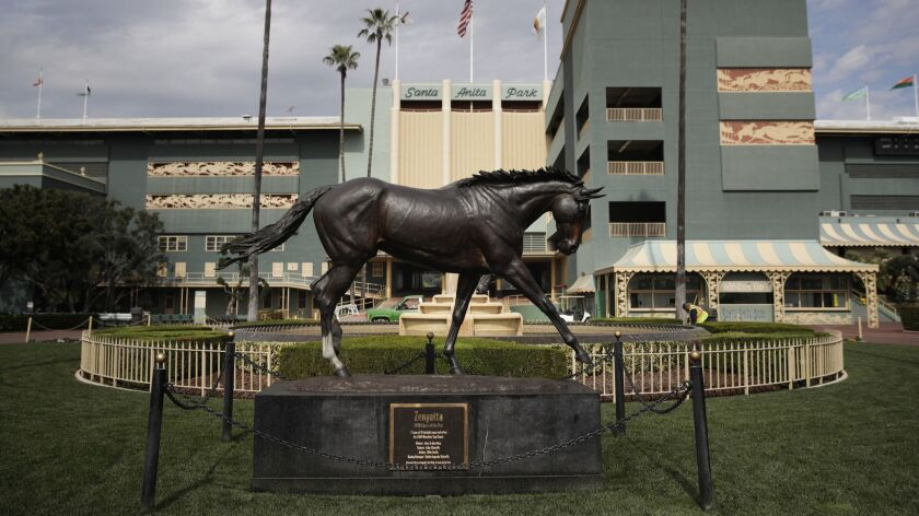 A statue of Zenyatta stands in the paddock gardens area at Santa Anita Park.
