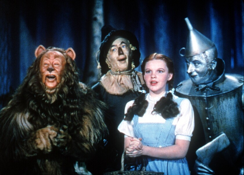 """The Cowardly Lion, the Scarecrow, Dorothy and the Tin Woodman in the movie """"The Wizard of Oz."""""""