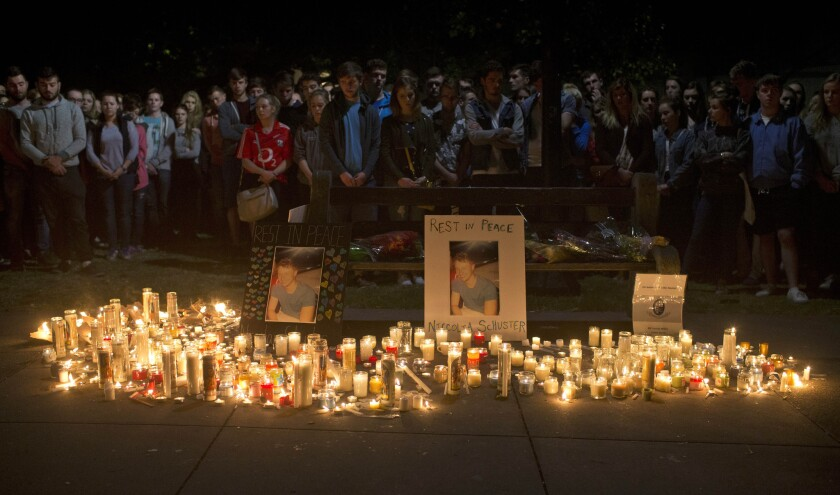 Mourners hold a vigil on June 17, 2015, for six students who died when an apartment building balcony collapsed in Berkeley.