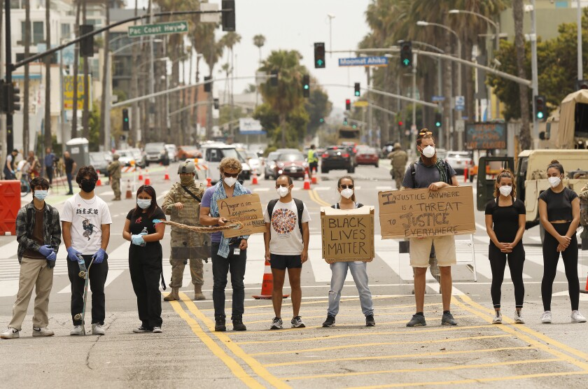 Black Lives Matter protesters stand in the middle of Ocean Avenue at Colorado in Santa Monica on June 1.