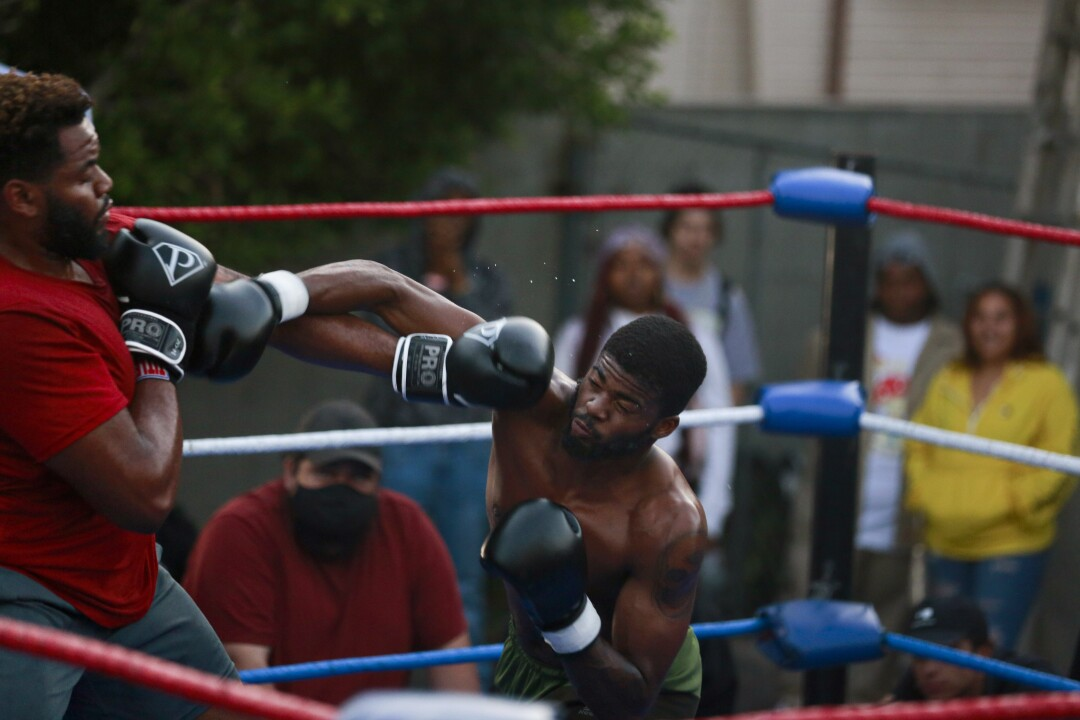 Albert 'Black Blade' Marion, right, competes against a fighter named Big Cheese in Los Angeles.