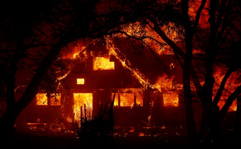 Near Healdsburg, Calif., a ranch house along State Highway 128 is consumed by the Kincade fire early Sunday.