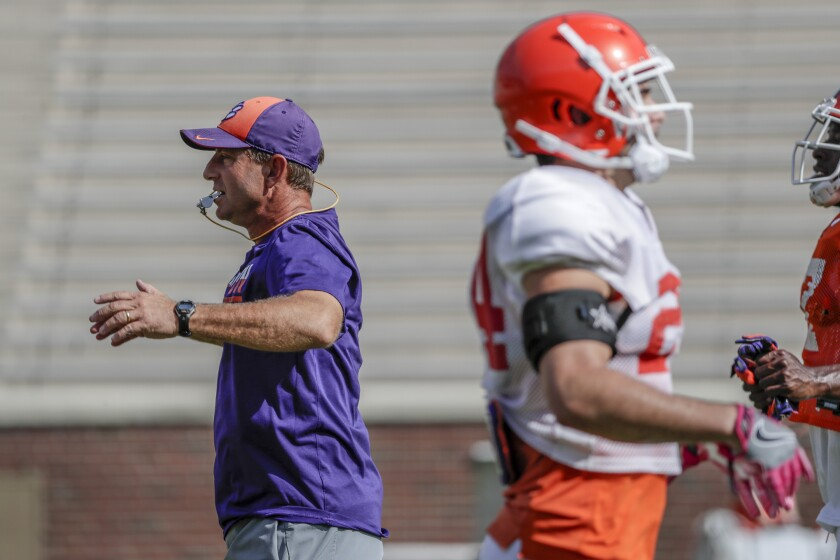 Clemson football coach Dabo Swinney conducts practice.