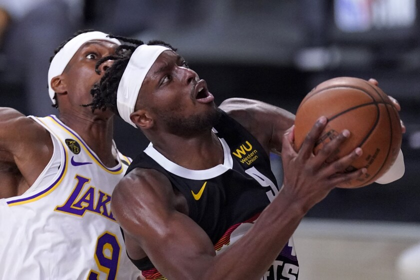 Nuggets forward Jerami Grant drives for a layup against Lakers guard Rajon Rondo during the second half of Game 3.
