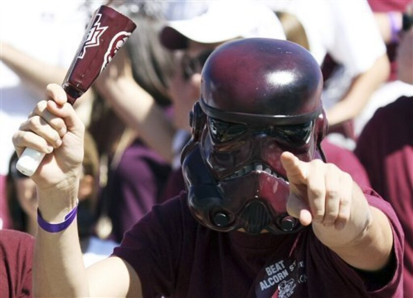"""A Mississippi State fan wears a """"Star Wars"""" mask to his school spirit before an NCAA college football game against Alcorn State at Davis Wade Stadium Saturday, Oct 2, 2010, in Starkville, Miss. (AP Photo/Kerry Smith)"""