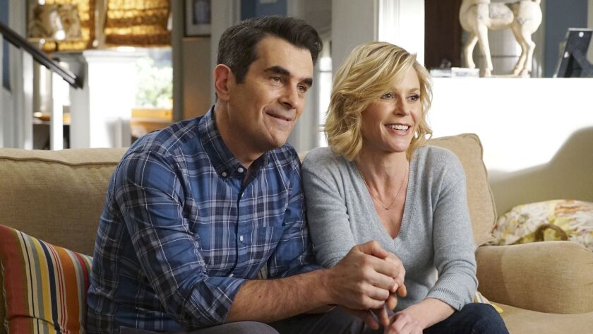 """Ty Burrell, left, and Julie Bowen in a scene from """"Modern Family."""""""