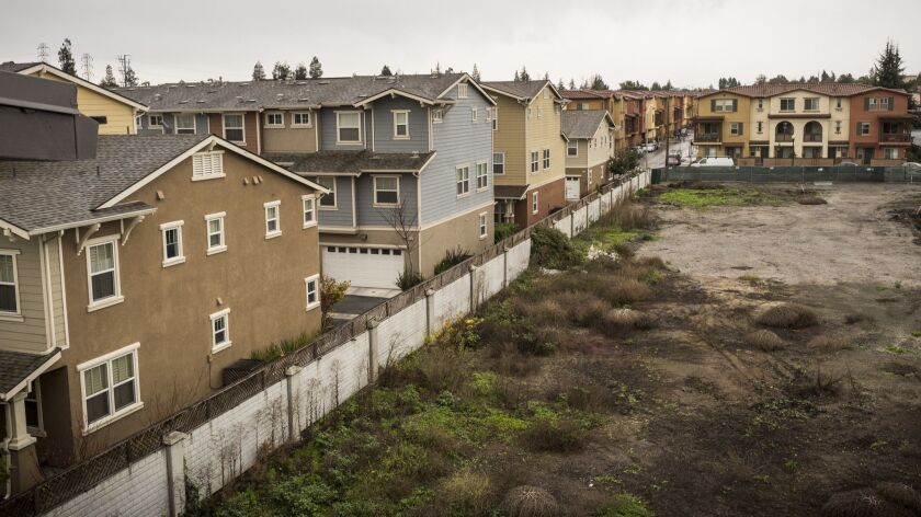 December 13, 2016 SUNNYVALE, CALIFORNIA A view of an empty lot and new housing. Sunnyvale is one of