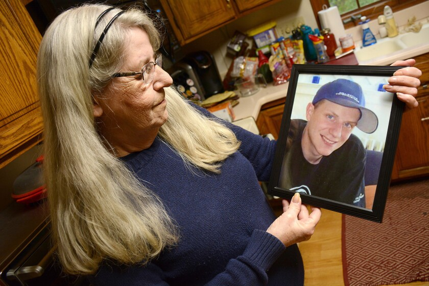 Maureen Heatley holds a photo of her son Todd who died while in custody of the NYS Department of Corrections and Community Supervision (DOCCS) at the Wende Correctional Facility in November of 2014.