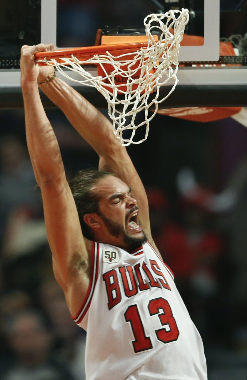 Chicago Bulls center Joakim Noah reacts after scoring against the Orlando Magic during the first half of an NBA basketball game, Sunday, Nov. 1, 2015, in Chicago. (AP Photo/Kamil Krzaczynski)