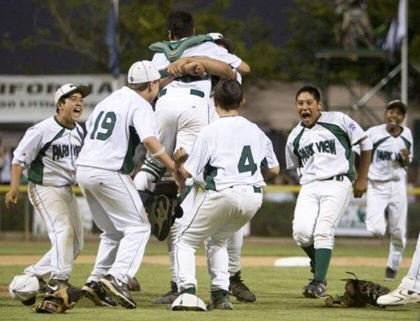 Park View team members pile on after winning the championship game of the Little League Western Region finals at Al Houghton Stadium in San Bernardino.